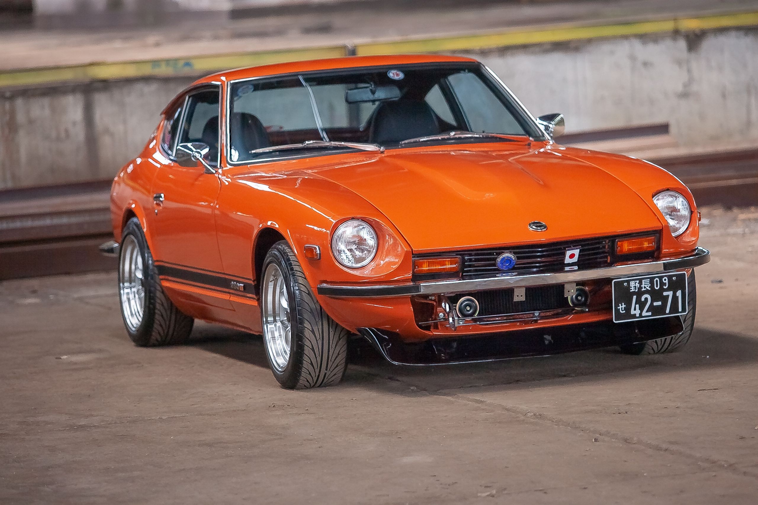 Totally restored Orange Nissan Datsun 280z for sale